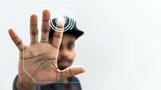 man scanning his finger