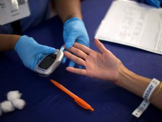diabetic having blood sugar tested