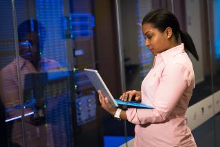 woman viewing laptop screen