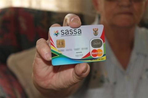 SASSA beneficiary holding up card