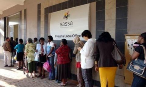 SASSA beneficiaries standing outside SASSA office