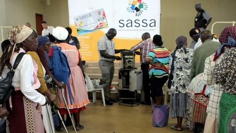 SASSA grant beneficiaries standing in line