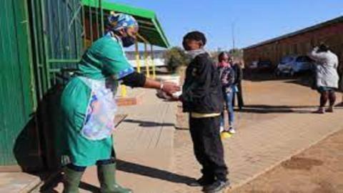 Pupils Receiving Food At School