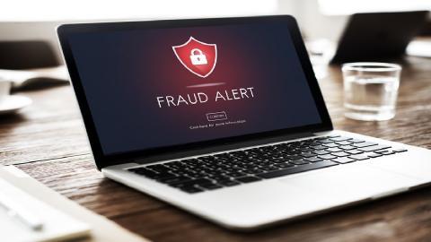 fraud warning on laptop screen