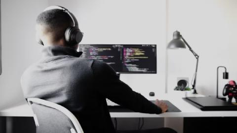 man sitting in front of desktop
