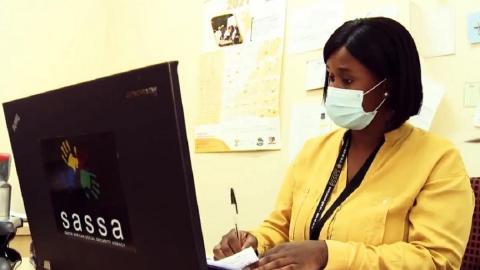 SASSA employee working on a desktop