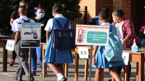 learners walking into school