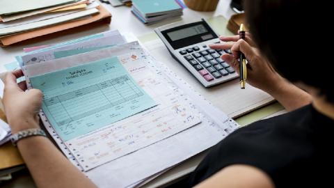 woman calculating money spent