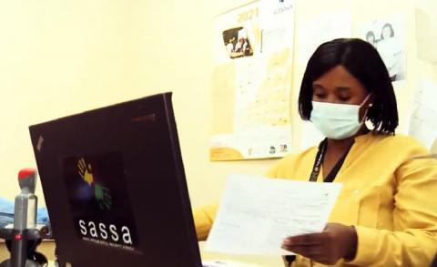 SASSA employee working in office