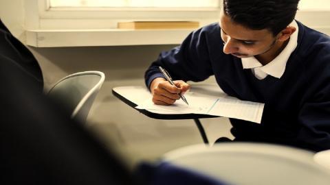 Young man writing an exam