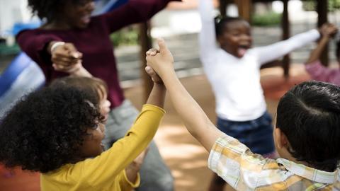 school children holding hands