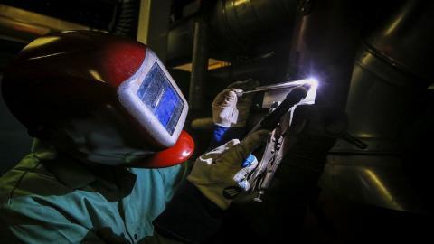 A metal worker welding