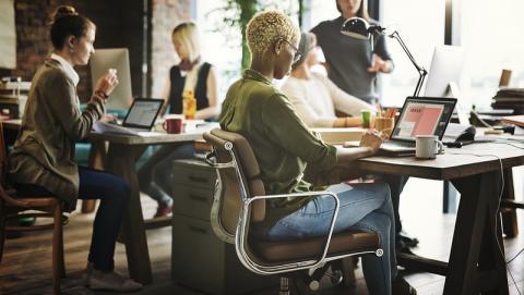 women in an office, using technology