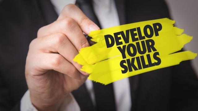 Man writing Skills development