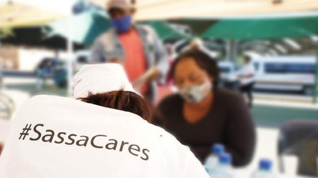 SASSA employees at sign up station