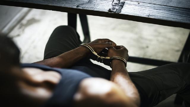 prisoner in hand cuffs