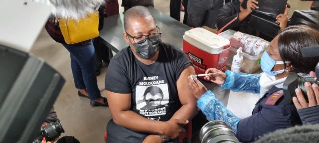 Gauteng education MEC Panyaza Lesufi receiving a vaccine jab